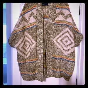 American eagle knitted poncho with snowflake back